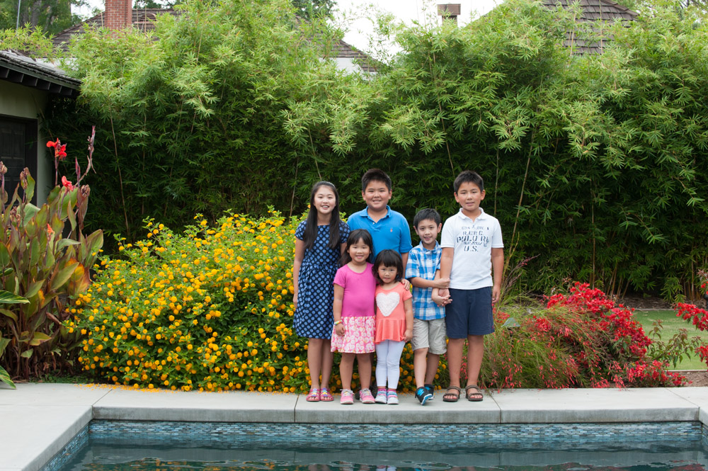 This San Marino family wanted family photos of their grandma and grandpa parents children and cousins We all met at their San Marino home in the morning and created these family photos around the swimming pool and in their lush green backyard I love having a session at someone